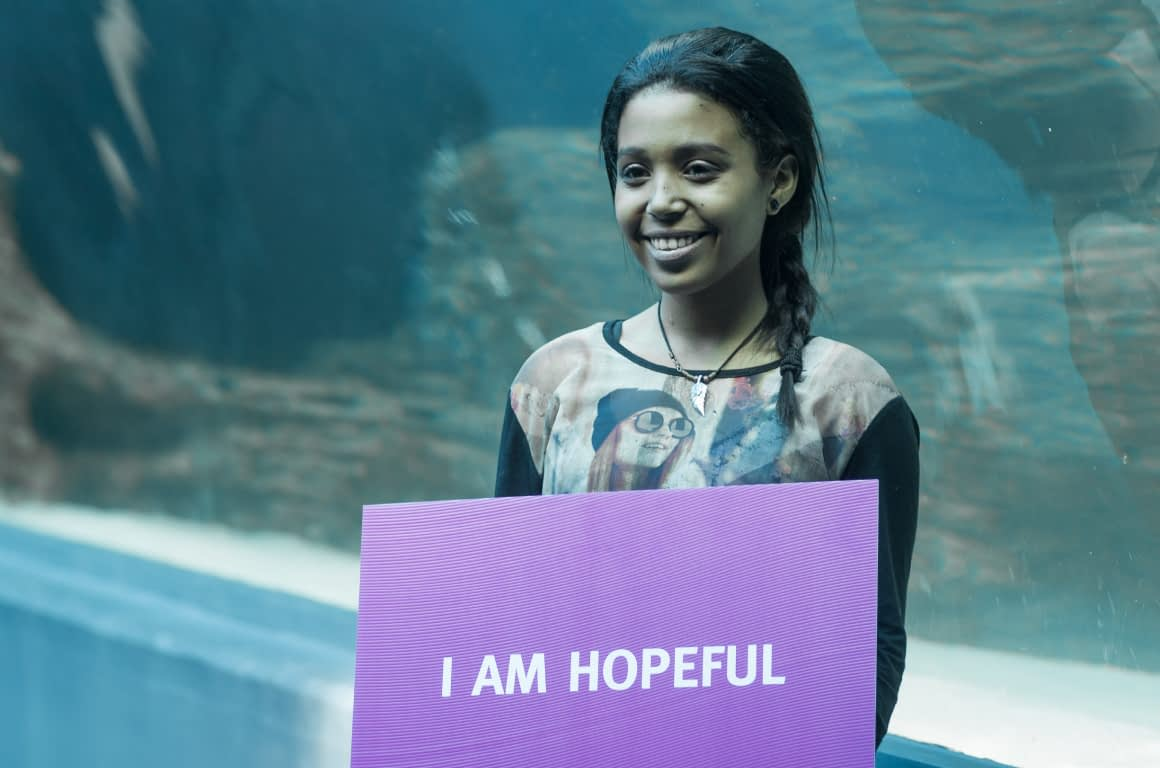 "Leukaemia Awareness Campaign - Behind The Scenes - Cancer Patient Holding Sign that reads ""I Am Hopeful"""